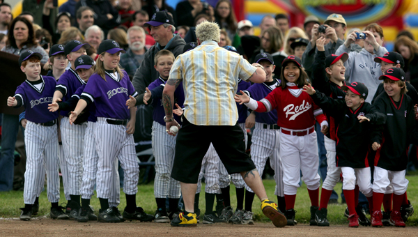 "After local restauranteur and television personality Guy Fieri showed up at the Mark West Youth Little League opening day to throw out the first pitch, Fieri high fived players from the Farms division.  According Mark West officials his appearance was ""Top Secret"", Saturday April 2, 2011 in Larkfield. (Kent Porter / Press Democrat) 2011"