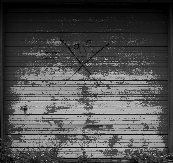 Faded and weatherbeaten, an X marks a home that was searched for victims in the aftermath of Hurricane Katrina in the Lower Ninth Ward.  (Kent Porter / Press Democrat) 2013