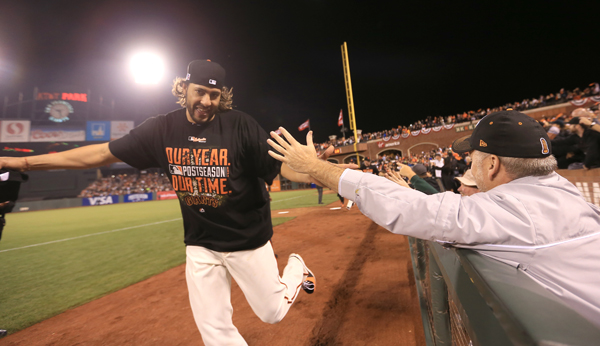 Madison Bumgarner takes a victory lap after the Giants beat the Nationals 3-2 to move to the NLCS, Tuesday Oct. 7, 2014 during game 4 of the NLDS at AT&T Park in San Francisco. (Kent Porter / Press Democrat) 2014