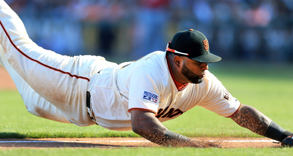 San Francisco Giants third baseman Pablo Sandoval dives for a bunt against the Nationals, Monday Oct. 6, 20134 during game 3 of the NLDS at AT&T Park in San Francisco. (Kent Porter / Press Democrat) 2014
