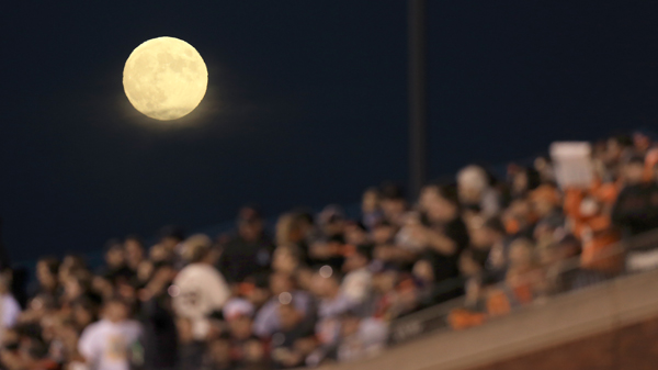 The full moon rises over AST&T Park, Tuesday Oct. 7, 2014 during game 4 of the NLDS at AT&T Park in San Francisco. (Kent Porter / Press Democrat) 2014