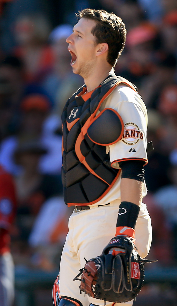 Buster Posey yawns at home plate, Monday Oct. 6, 20134 during game 3 of the NLDS at AT&T Park in San Francisco. (Kent Porter / Press Democrat) 2014