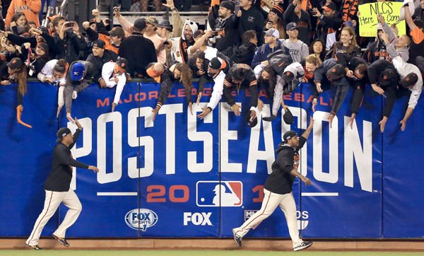 The Giants take a victory lap after beating the Nationals 3-2 to move to the NLCS, Tuesday Oct. 7, 2014 during game 4 of the NLDS at AT&T Park in San Francisco. (Kent Porter / Press Democrat) 2014