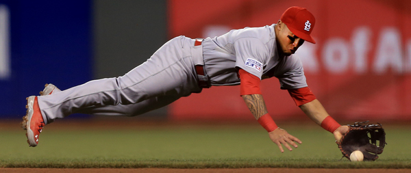 Kolten Wong  of St. Louis dives for a Travis Ishikawa liner in the second inning, throwing him out, during game 4 of the National League Championship Series at AT&T Park in San Francisco, Wednesday Oct. 15, 2014.  (Kent Porter / Press Democrat) 2014