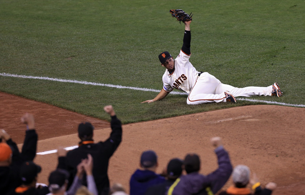 Juan Perez made a circus catch off the bat Alex Gordon during game 4 of the World Series in San Francisco, Saturday Oct. 25, 2014. (Kent Porter / Press Democrat) 2014