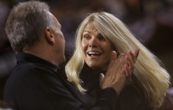 "Jennifer and Joe Montana sing ""Take me out to the ball game"", during game 5 of the World Series in San Francisco, Sunday Oct. 26, 2014. (Kent Porter / Press Democrat) 2014"