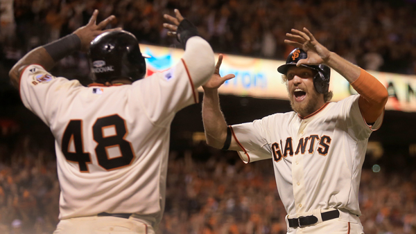 Hunter Pence and Pablo Sandoval celebrate after scoring on Juan Perez's double in the eighth inning to break the game open during game 5 of the World Series in San Francisco, Sunday Oct. 26, 2014. (Kent Porter / Press Democrat) 2014
