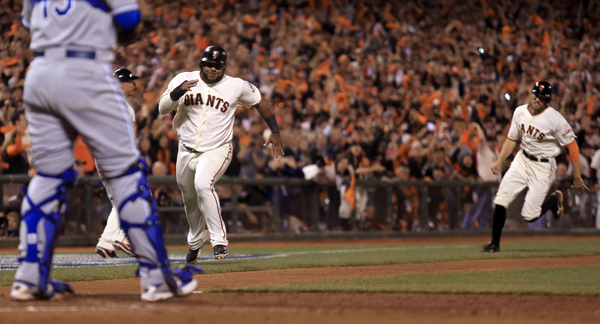 Pablo Sandoval, left and Hunter Pence sprint towards home after a Juan Perez double in the eighth inning during game 5 of the World Series in San Francisco, Sunday Oct. 26, 2014. (Kent Porter / Press Democrat) 2014