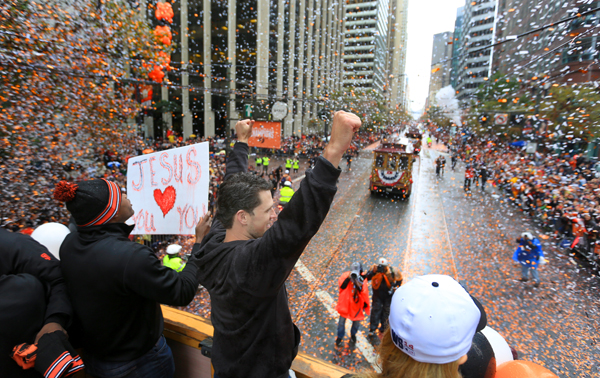 Buster Posey acknowledges the crowd as the Giants take a World Series victory parade, Friday Oct. 31, 2014 in San Francisco. (Kent Porter / Press Democrat) 2014
