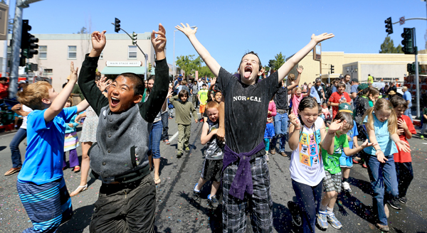 Kids cool off at the end of the Apple Blossom Parade in Sebastopol, Saturday April 18, 2015 assisted by a Graton Fire Protection District engine. (Kent Porter / Press Democrat) 2015