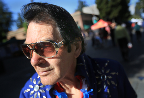 Dan Bighaus of Santa Rosa as Elvis, during Santa Rosa's Wednesday Night Market, May 6, 2015.    (Kent Porter / Press Democrat) 2015