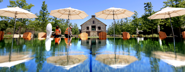 An infinity pool reflects wine country outdoor decor at Hall Wines in St. Helena, Wednesday May 27, 2015. The winery will be the site of this year's barrel tasting kicking of Auction Napa Valley.  (Kent Porter / Press Democrat) 2015