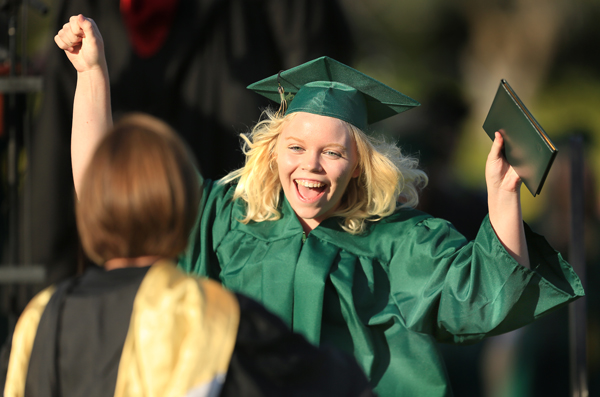Maria Carrillo's Erin Dobler celebrates after receiving her diploma as she runs to thank science teacher Maggie Swarner with a hug during Maria Carrillo's High School commencement. Friday June 5, 2015 in Santa Rosa.   (Kent Porter / Press Democrat) 2015