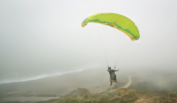 At Goat Rock State Beach in Jenner, East Bay resident David Shelley paraglides off the bluff above Goat Rock State Beach, Wednesday June 17, 2015,  Because of the drought, area beaches along the coast received high grades for cleanliness caused by less winter runoff. (Kent Porter / Press Democrat) 2015
