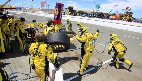 A pit crew member of the Dollar Rental was clubbed in the face by and errant tire during the Toyota/Savemart 350 at Sonoma Raceway, Sunday June 28, 2015.  (Kent Porter / Press Democrat) 2015