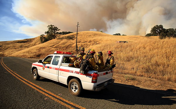 The Boggs Helitac crew gets a ride from a battalion chief on the Rocky Fire, Wednesday July 29, 2015. (Kent Porter / Press