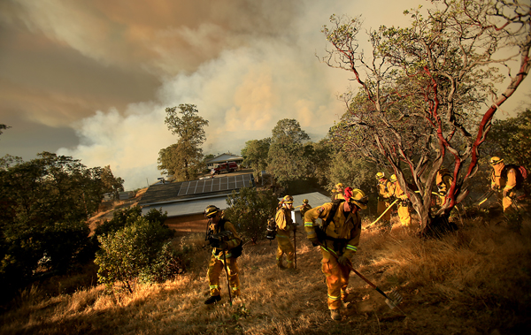 Lake-Napa Unit crew 1, cut a fire line around a home during the Rocky fire August 29, 2015. (Kent Porter / Press Democrat) 2015