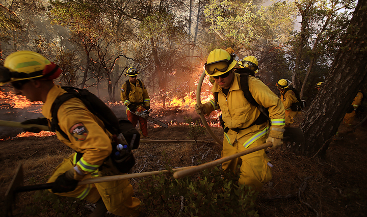 A Cal Fire Crew bugs out of a flare up on the Rocky Fire near Lower Lake  as they try to cut line around the perimeter of the fire, Wednesday July 29, 2015. (Kent Porter / Press Democrat) 2015