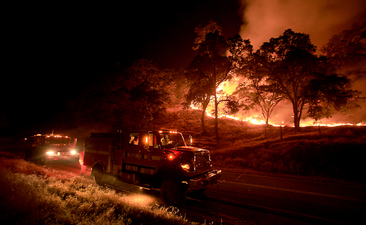 Cal Fire crews from Napa's Greenwood Ranch Station monitor the Rocky Fire, now 8,000 acres, Thursday  July 30, 2015. (Kent Porter / Press Democrat) 2015