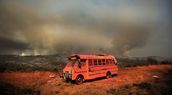 An old school bus was coated with phoschek during the first day of the Rocky fire.