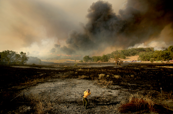 The Rocky fire made a run through bone dry brush on July 30, leaving a black landscape. (Kent Porter / Press Democrat) 2015