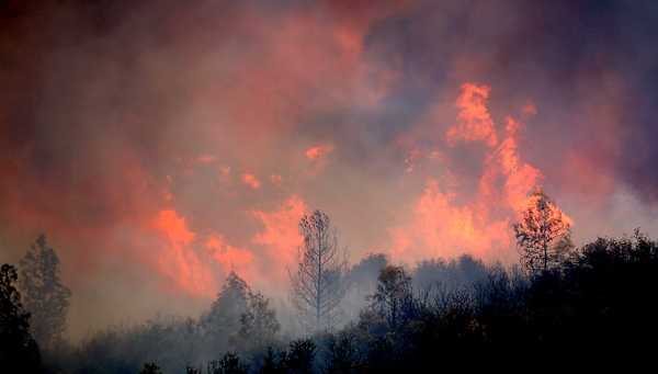 The Rocky Fire exhibits extreme rates of spread as it jumps to the north side of Highway 20 east of Spring Valley in Lake County, Monday Aug. 3, 2015. (Kent Porter / Press Democrat) 2015