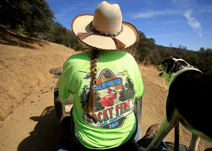 Lonne Sloan bought a T-shirt commemorating the Rocky fire after firefighters helped to save her home, Tuesday Sept. 1,  2015.  (Kent Porter / Press Democrat) 2015 near Lower Lake.