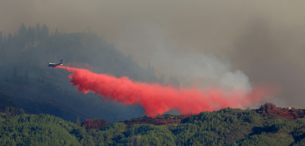 A BAE-146 drops on Pitney Ridge during the Elk fire in Upper Lake, Wednesday September 2, 2015. (Kent Porter / Press Democrat) 2015