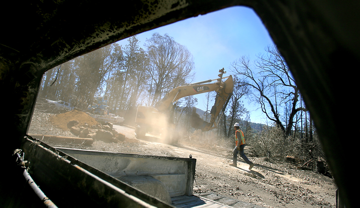 Pacific Gas and Electric crews are busy replacing the power line infrastructure in the Valley fire burn area,  An excavator is used to remove and auger out the existing hole where a burned power pole was damaged on Humboldt Road in Hobergs, Tuesday Sept. 22, 2015.  (Kent Porter / Press Democrat) 2015