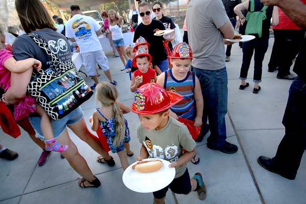 fire hats were given out to kids during a Valley fire town meeting and barbecue at  Middletown High school, Thursday Sept. 24, 2015.  (Kent Porter / Press Democrat) 2015