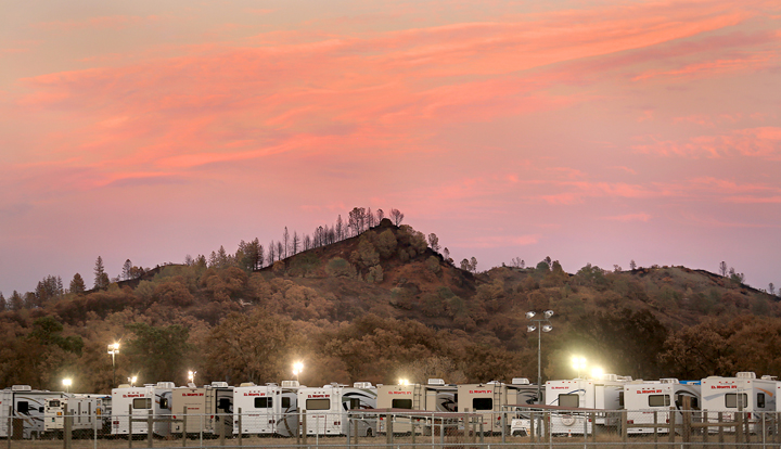 Valley fire scarred hills in Middletown provide a backdrop for motor homes brought in to house Pacific Gas and Electric Company crews as they continue to replace power infrastructure in the burn area , Thursday Sept. 24, 2015.  (Kent Porter / Press Democrat) 2015