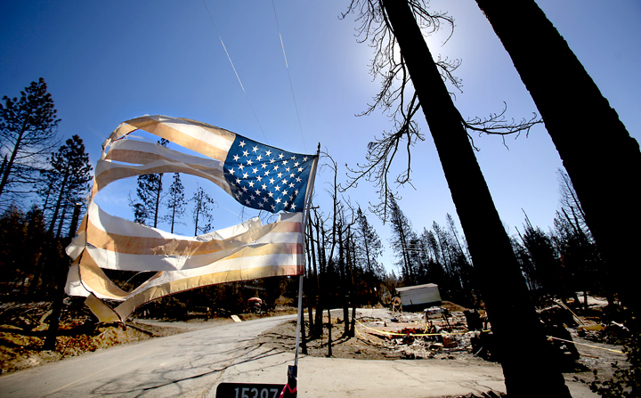 An American Flag in the Valley fire zone on Cobb Mountain, Tuesday Oct. 6, 2015.   (Kent Porter / Press Democrat) 2015