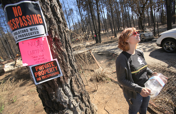 Samantha Wood and her husband Josh placed placards around their property warning crews not to cut their trees, Wednesday Oct. 7,  2015 in Cobb.  (Kent Porter / Press Democrat) 2015