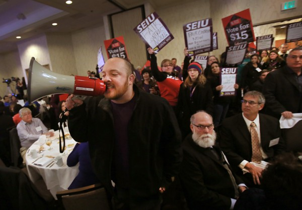 Protesters from the SEIU 1021 rush their way past security guards during the State of the County report at the Double Tree Hotel in Rohnert Park Wednesday, January 27, 2016. (Kent Porter / Press Democrat) 2016