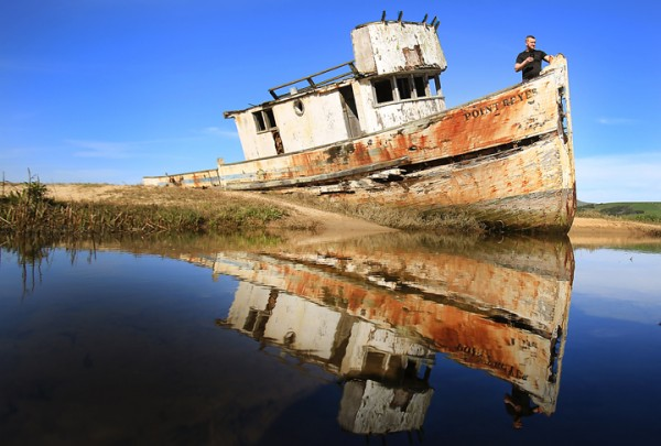 Stanislaw Swiech of Chicago takes in the Tomales Bay aboard the Pt. Reyes shipwreck, an iconic destination of photographers and tourists alike in Inverness, Thursday Feb. 25, 2016. Several nights ago, the boat caught fire, hours after a photoshoot burning the entire stern of the vessel. (Kent Porter / Press Democrat) 2016