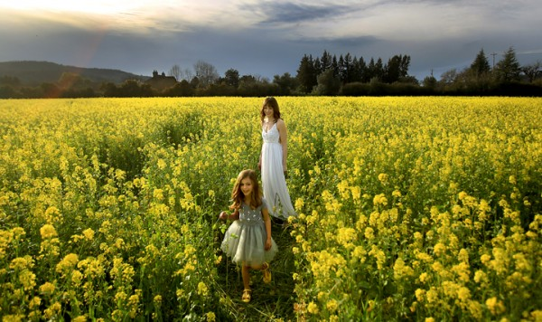 Lillie Smallcomb, 5. and her mother Jennie of Santa Rosa take advantage of the warm weather to relax in a mustard field near Kenwood, Monday Feb. 29, 2016 as they prepare to model dresses for a commercial photographer.  (Kent Porter / Press Democrat) 2016