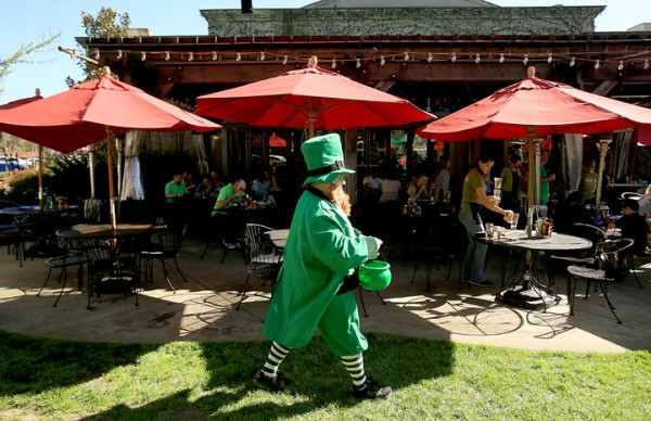 Greendog Rescue volunteer  Gary Archuleta  carries his pot of gold during the Annual Drinks for the Dogs event, Thursday March 17, 2016 at the Healdsburg Bar and Grill. (Kent Porter / Press Democrat) 2016