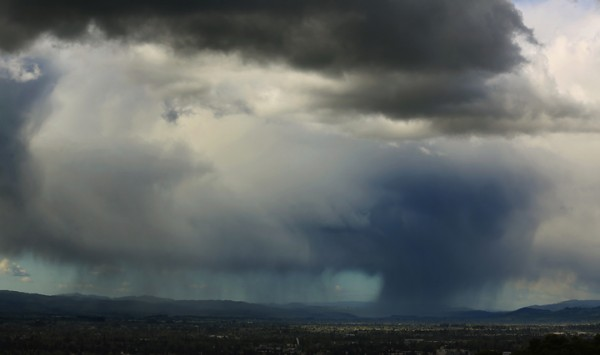 Rain and hail fall over the Alexander Valley as seen from Taylor Mountain Regional Park and Open Space Preserve Monday March 28, 2016. (Kent Porter / Press Democrat) 2016