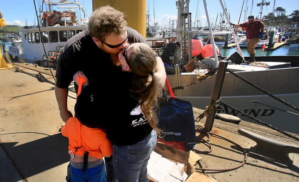 Justin Davis, skipper of the Night Wind, says goodbye to his wife Deserie Davis and son Ivan as his crew prepares to head out crabbing after months of delay, Tuesday March 29, 2016 at Spud Point Marina in Bodega Bay. (Kent Porter / Press Democrat) 2016