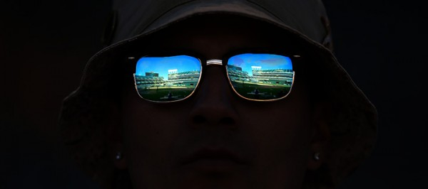 An Oakland Athletics fan looks out on the Oakland Coliseum during their home opener against the Chicago White Sox, Monday April 4, 2016. (Kent Porter / Press Democrat) 2016