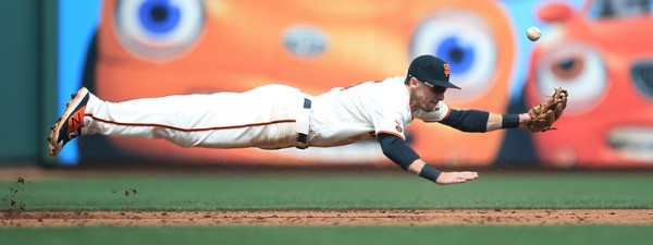 Giants third baseman Matt Duffy dives for a hot liner off the bat of Dodger  Yasiel Puig in the third inning-he later scored- during opening day at AT&T Park in San Francisco, Thursday April April 7, 2016. (Kent Porter / Press Democrat ) 2016