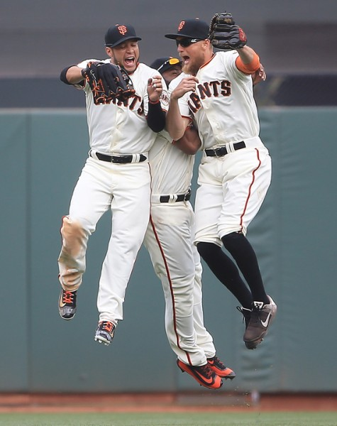 Gregor Blanco, Denard Span and Hunter Pence celebrate the Giants victory during their opener against the Dodgers at AT&T Park in San Francisco, Thursday April April 7, 2016. (Kent Porter / Press Democrat ) 2016