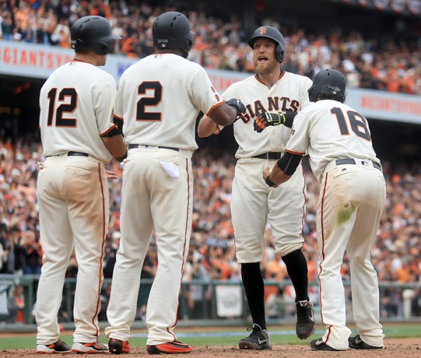 Hunter Pence greets, from left, Joe Panik, Denard Span, Angel Pagan at home after smacking a grand slam in the eighth inning, during the  Giants opening day against the Dodgers at AT&T Park in San Francisco, Thursday April April 7, 2016. (Kent Porter / Press Democrat ) 2016