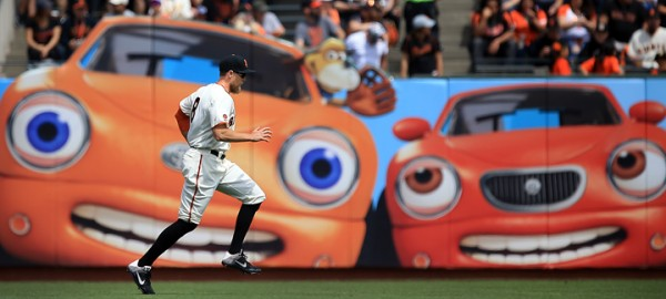 Giants right fielder Hunter Pence limbers up before the Giants home opener against the Dodgers, Thursday April 7, 2016. (Kent Porter / Press Democrat) 2016