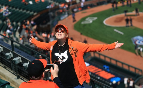 Ashley Brown of Concord is photographed by friend Paul Bryson of San Francisco prior to the Giants opening day against the Dodgers at AT&T Park in San Francisco, Thursday April April 7, 2016. (Kent Porter / Press Democrat ) 2016