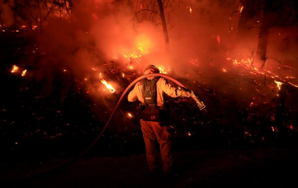Bennett Leda of Healdsburg's Cal Fire station monitors the Clayton fire as it approaches Morgan Valley Road near Lower Lake, Sunday August 14, 2016 in Lake County. (Kent Porter / Press Democrat) 2016