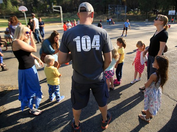 Cal Fire dozer operator Drew Bohan joined his wife Nahani, left, for their daughters first day of kindergarten at Cobb Elementary School, Wednesday Aug. 10, 2016. Lohan wears a shirt dedicated to the 104 Boggs helitac crew that was burned over in the early stages of the Valley fire. (Kent Porter / The Press Democrat) 2016