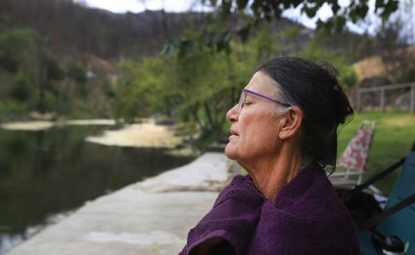 Margit Pataki meditates after taking a swim in Anderson Springs Monday Aug. 29. A resident of Rose Anderson Road in the the community of Anderson Springs, Pataki lost her home of 20 years to the the 2015 Valley fire. (Kent Porter / The Press Democrat) 2016