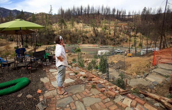 Slowly, Jacqueline Bartlett's home in Anderson Springs is being rebuilt, Monday Aug. 29, 2016. Nearly to the end of Anderson Springs Road, tucked in to a hillside, the Valley fire burned nearly every home in the community, including the Bartlett home. (Kent Porter / The Press Democrat) 2016