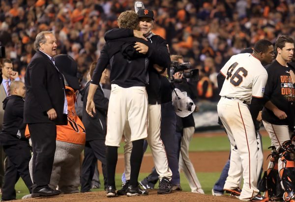 Hunter Pence and Bruce Bochy embrace after the Giants beat the Nationals to move to the NLCS, Tuesday Oct. 7, 2014 during game 4 of the NLDS at AT&T Park in San Francisco. (Kent Porter / Press Democrat) 2014